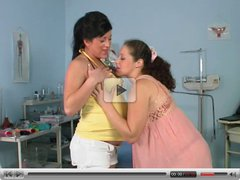two pregnant girls playing in gyno room