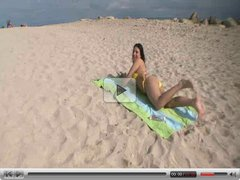 Big titty Rikki Nix gets oiled up in the beach and gets then