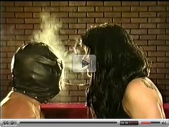 Leather Gloved Brunette Dominatrix Smoking Torture Up-Close