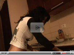 Dirty slut rubs and fingers cunt in kitchen