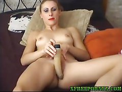 Sweetie plays with her pussy