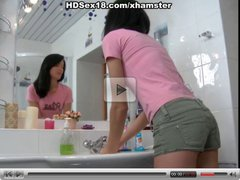 Hot brunette squirting in bathroom