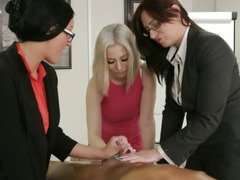 Group of femdoms in the office giving handjob