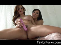 Two naturally busty lesbians using sex toys