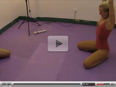 JC Simpson Stretching in Leotard and Tights before grappling