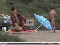 Two mature couples having fun at nude beach