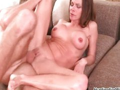 Hot brunette milf gets horny sucking