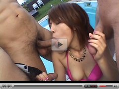 Japanese hottie sucks off three cocks by the pool