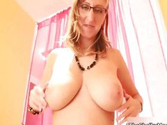 Busty blonde whore rubs her huge boobs