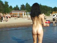 Slim teen with perky boobs naked at a nudist