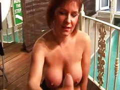 Mature lady tugs cock and gets cumshot