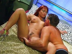 Redhead has anal sex with mature guy