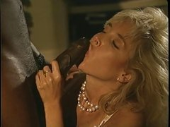 A horny old blonde slut rides a stiff black cock of steel