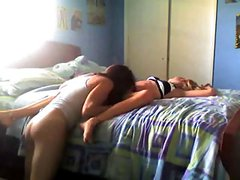 Two young girls playfully on bed