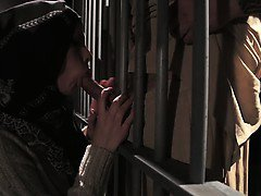 Muslim babe sucking dick through jail bars