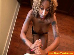 Blonde ebony babe tugs on white cock
