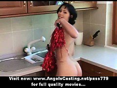 Wonderful lovely short hair brunette cheerleader undressing in the kitchen