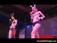 Stripper babes on stage toying pussies and teasing