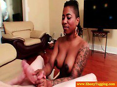 Amateur black nubian with tattoos giving handjob