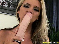 Bambi grabs her dildo to fuck herself nicely.