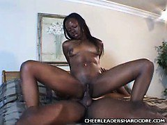 Ebony Cheerleader Takes Cock Plugging