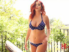 Lucy V strips from her blue and white polka dots on the day