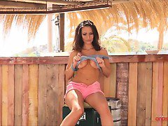 Anastasia strips from her pink denim shorts