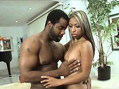 Asian babe gags on big black cock