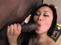 Tight Asian pussy filled with black cock