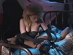 Wild Haired blonde bitch sucks off a mature Tranny's cock