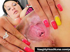 Lady nurse practitioner playing with herself with gyno-tool