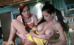 Two lesbian porn actresses undress and fondle each other in the kitchen