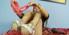 Lustful bimbo fucks her swollen pussy with her sex toys