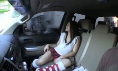 Seductive Asian babe in sexy kilt skirt masturbates in the car