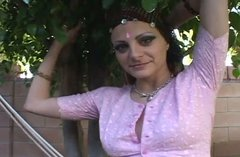 Lubricious brunette in Indian outfit gets her pierced clit polished