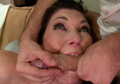 MILF gives a blow job with plastic dildo sticked in her asshole.