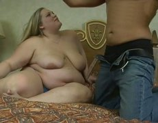 Caucasian BBW hoe is getting her pussy rubbed before she gives hot titjob