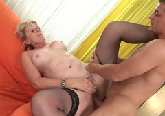 Old woman in black stockings rides on cock like a true cowgirl