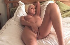 Small tittied blonde masturbates her shaved pussy in solo