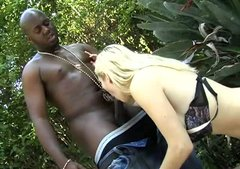 Whorish blonde Celestia gives blowjob to big black guy