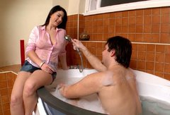 Sexy brunette GF gives head to her lover in the bathroom