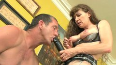 Mature hoe in stockings fucks her buff stud with strapon