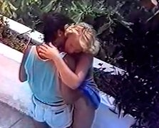 Brazen curly haired blondie gives blowjob on the balcony