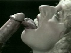 Retro slut in white stockings strips and blows dong