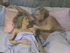 Torrid blonde vixen Sharon Kane gets doggyfucked on retro video