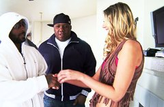 Blonde slut is going to serve several black dudes at the same time
