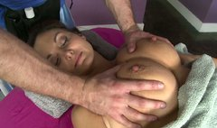 Awesome busty brunette gets erotic massage and her pussy tickled