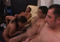 Shabby brunette whore gives head to bunch of horny dudes that sit in line