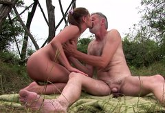 Lustful bitch with ample rump is riding hard stick of old daddy fucking outdoor