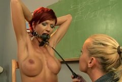 Busty red haired teacher is tortured by kinky student. BDSM